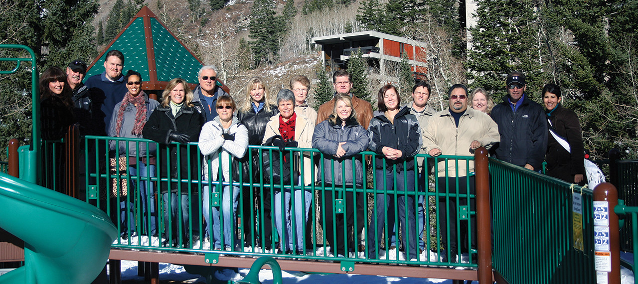 Group poses for photo on playground structure