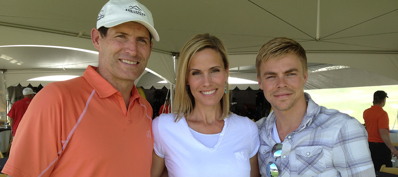 Steve Young, Barb Young, and Derek Hough pose for photo