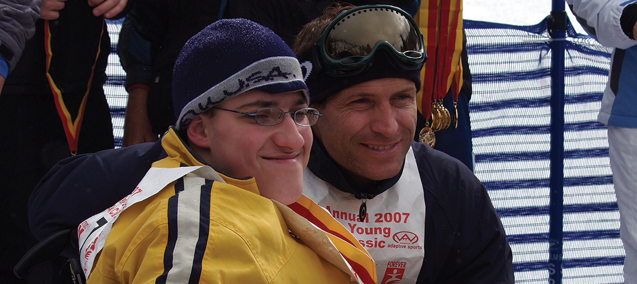 Steve Young with a fan at the Ski Classic