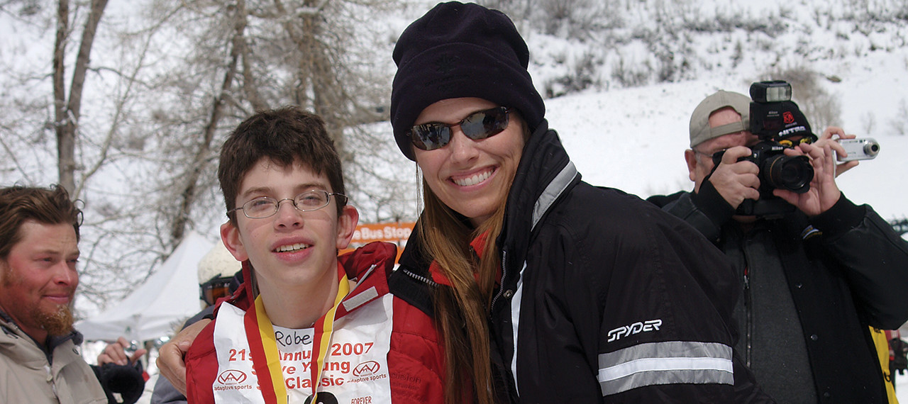 Barb Young with boy at Ski Classic