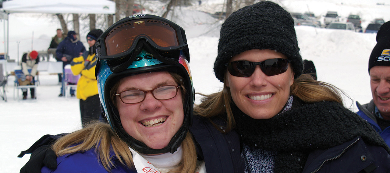 Barb Young poses with a new friend at Ski Classic