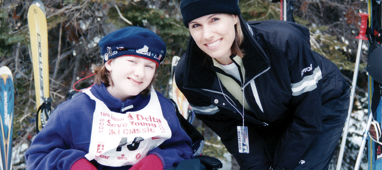 Barb Young with child at Ski Classic