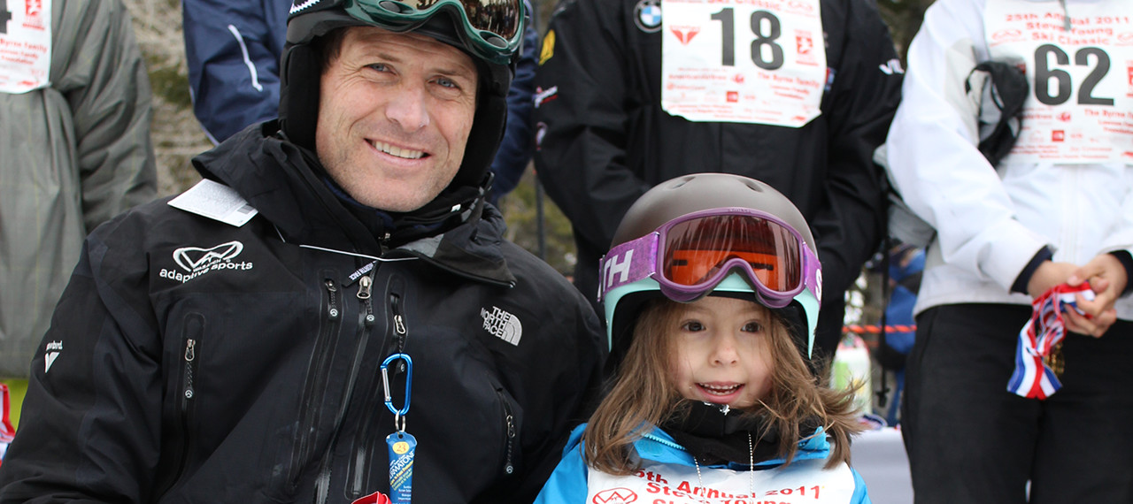 Steve Young and excited girl ready to ski