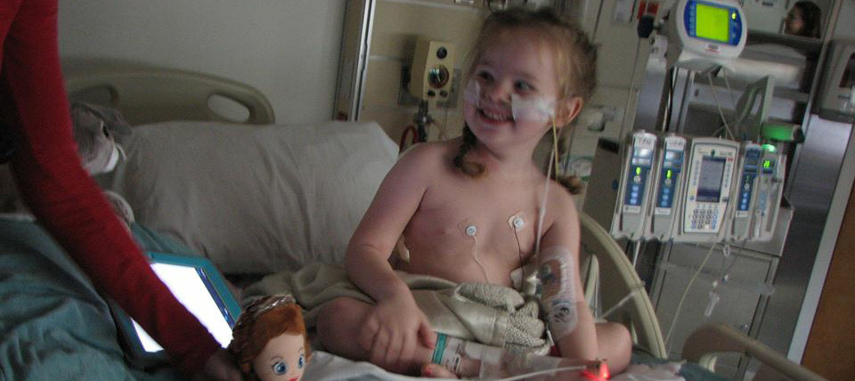 Smiling child in hospital bed