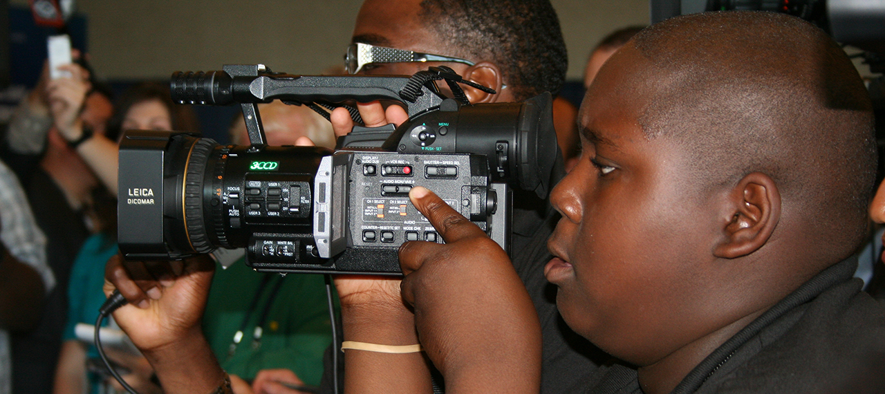 Boy focused on filming with camera