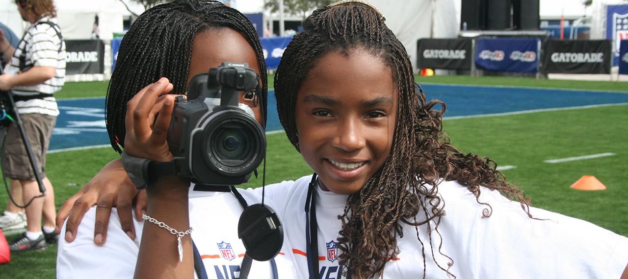 Girls smile for camera