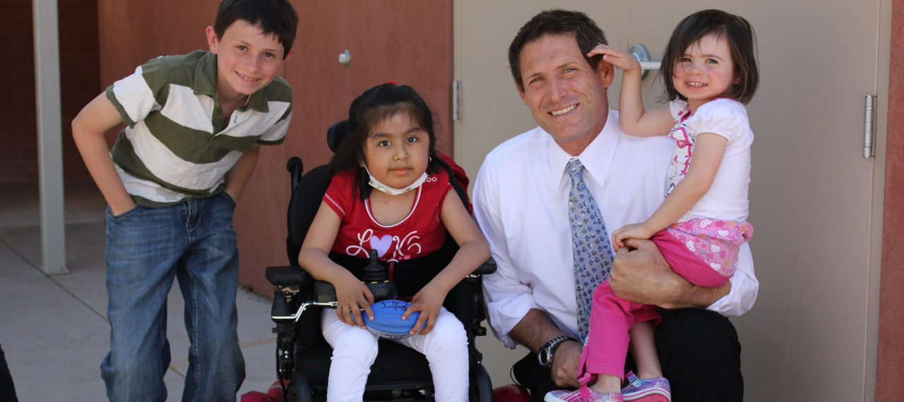 Steve Young Posing With Children
