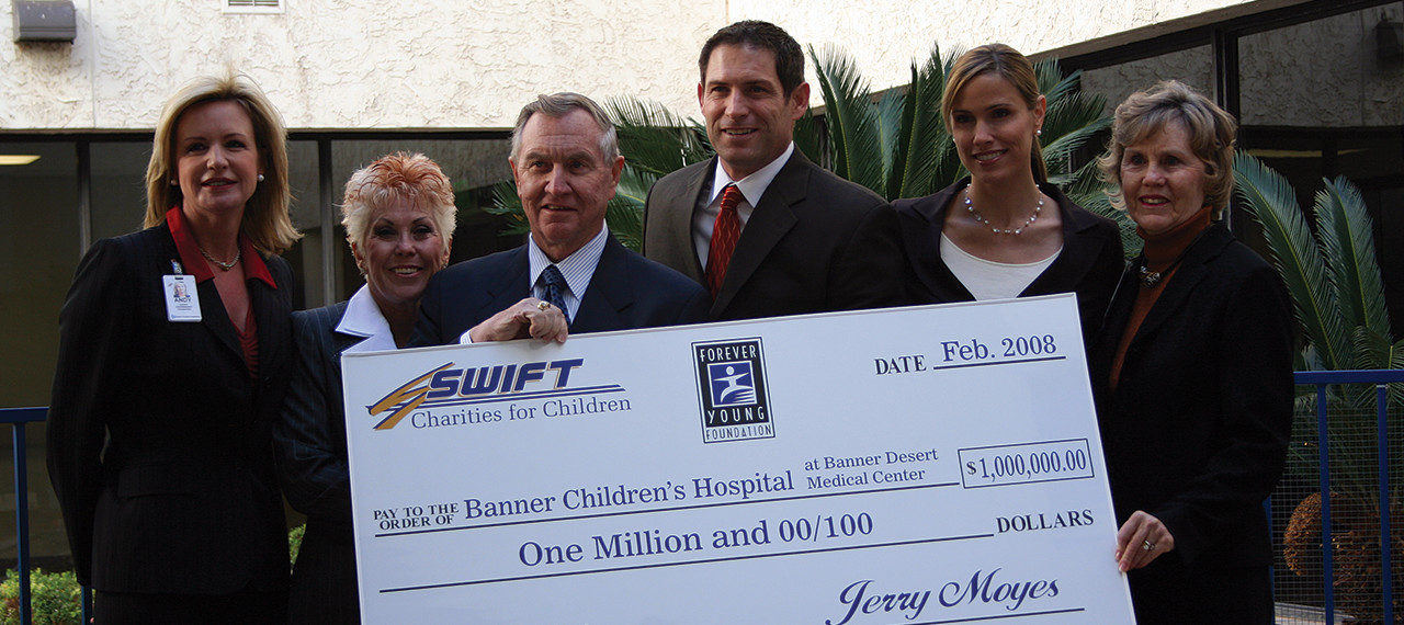 Steve and Barb Young pose with 1 million dollar check to Banner Children's Hospital
