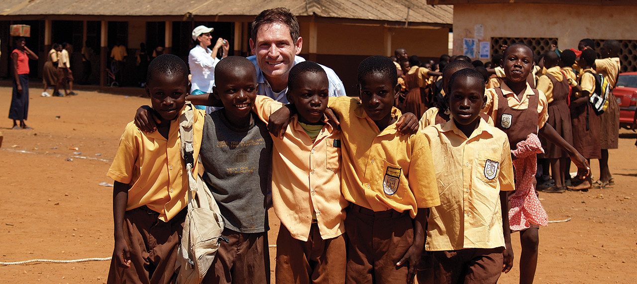 Steve Young with new friends in Africa